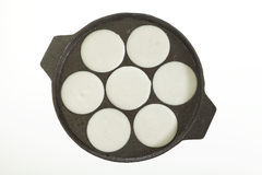 Pan filled with rice paste to cook Idly in idli pan. Royalty Free Stock Photo