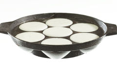Pan filled with rice paste to cook Idly in idli pan. Royalty Free Stock Images
