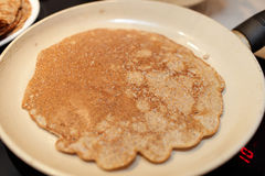Pan with flaxseed meal pancake. At home royalty free stock photography