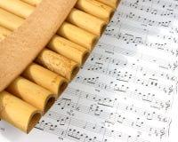 Pan fluit en nota's Stock Afbeelding