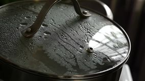 Pan with fogged lid. cooking at home. slow motion. Pan with fogged lid. cooking at home stock footage