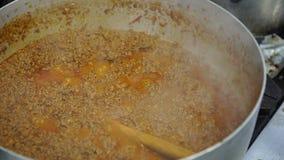 A pan fool of meat sauce boiling, 4K. A pan fool of meat sauce boiling stock video footage