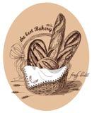 Pan fresco en la cesta con el texto Imagen de archivo
