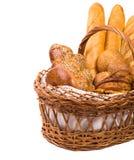 Pan fresco en la cesta en el blanco Imágenes de archivo libres de regalías