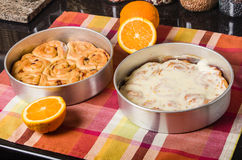 Pan of fresh baked iced sweet rolls Stock Photography