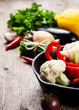 Pan and fresh vegetables Royalty Free Stock Images