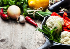 Pan and fresh vegetables Royalty Free Stock Photos