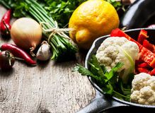 Pan and fresh vegetables Royalty Free Stock Image