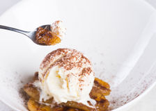 Pan fried banan with vanilla ice cream Royalty Free Stock Photography