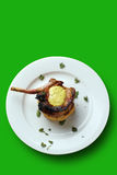 Pan fried or barbecue pork with clipping path. Pan fried pork cutlet on a tomato capsicum cous-cous with lime aioli (lime, olive oil, and egg). Will also suffice Royalty Free Stock Photography