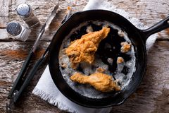 Pan Fried Chicken. Delicious pan fried chicken in a cast iron frying pan stock photo