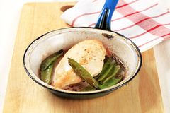 Pan fried chicken fillet and snow peas Royalty Free Stock Image