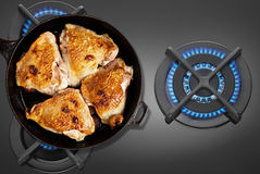 Pan fried chicken on the gas stove Stock Images