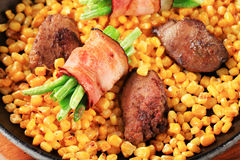 Pan fried chicken liver with sweetcorn and green beans in bacon. Sweetcorn with fried chicken liver and bacon-wrapped green beans Royalty Free Stock Photography
