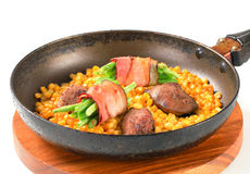Pan fried chicken liver with sweetcorn and green beans in bacon Stock Photography
