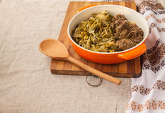 Pan-fried chicken livers with green beans and  onions Royalty Free Stock Image