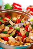 Pan with fried chicken and vegetables Royalty Free Stock Photo