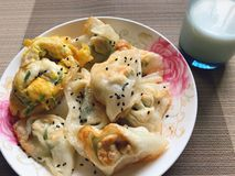 Pan fried dumplings and egg with milk royalty free stock image