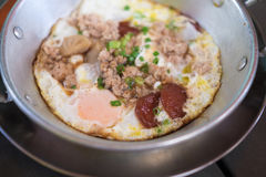 Pan fried egg with pork and toppings Stock Photos