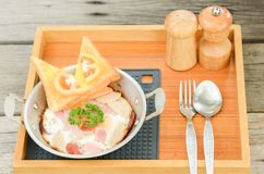 Pan-fried egg with toppings on wooden background. Breakfast food in Thai style royalty free stock photography