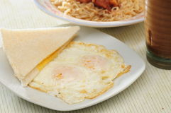 Pan fried eggs Stock Image