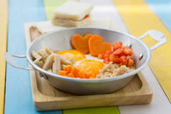 Pan fried eggs and sandwiches Royalty Free Stock Images