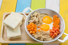 Pan fried eggs and sandwiches Stock Photo