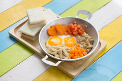 Pan fried eggs and sandwiches Stock Photography