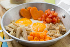 Pan fried eggs and sandwiches Stock Images