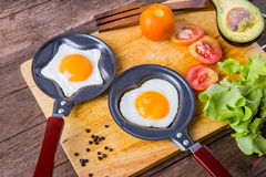Pan of fried eggs, with vegetable Royalty Free Stock Photography