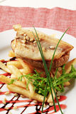 Pan fried fish fillet and fries Stock Image