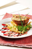 Pan fried fish fillet and fries Royalty Free Stock Images