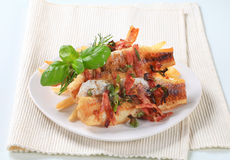 Pan fried fish fillets with fries Royalty Free Stock Images