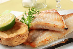 Pan fried fish fillets and potato Stock Photos