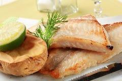 Pan fried fish fillets and potato Stock Photos
