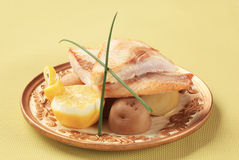 Pan fried fish fillets and potatoes Stock Images