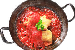 Pan fried fish fillets with tomato sauce Stock Image