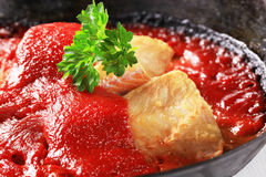Pan fried fish fillets with tomato sauce Royalty Free Stock Image