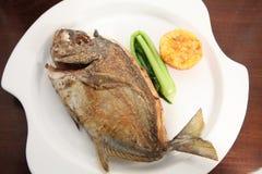 Pan fried fish food portion. Makassar famous fried fish seafood Stock Photos