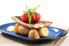 Pan fried fish with potatoes Royalty Free Stock Photography