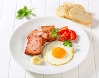 Pan-fried Leberkase with sunny side up fried egg Stock Images
