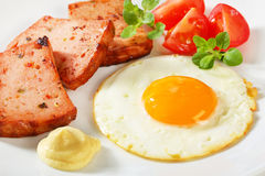 Pan-fried Leberkase with sunny side up fried egg Royalty Free Stock Images