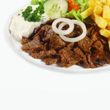Pan-fried meat, French fries and fresh vegetables Royalty Free Stock Photos