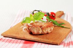Pan fried meat patty Stock Images