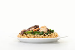 Pan fried noodles with mushroom Stock Photos