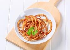 Pan-fried onion strings Stock Photo