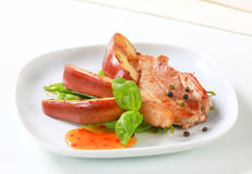 Pan fried pork and apple slices Royalty Free Stock Image