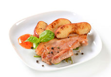 Pan fried pork and apple slices Royalty Free Stock Photo
