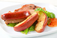 Pan fried pork and apple wedges Stock Image