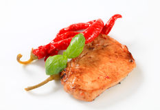 Pan-fried pork chop with chili peppers Stock Image